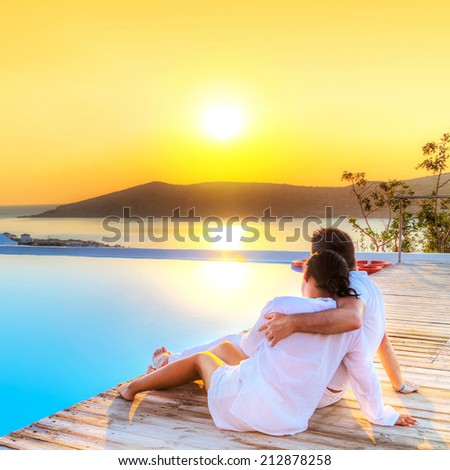 Couple in hug watching together sunrise in Greece - stock photo
