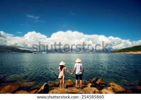 Couple in love at sunset. Beach. - stock photo