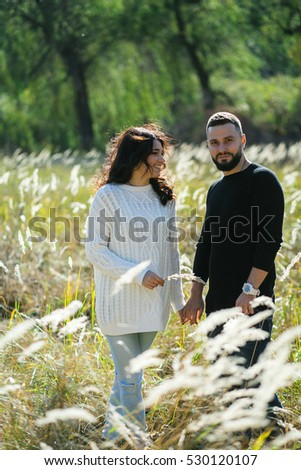 Couple in love - Beginning of a Love Story. A man and a girl on the nature while walking
