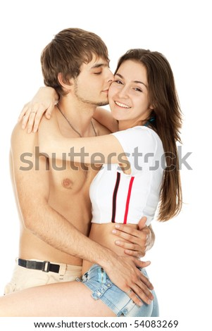 couple in love, boy kisses laughing girl isolated on white - stock photo