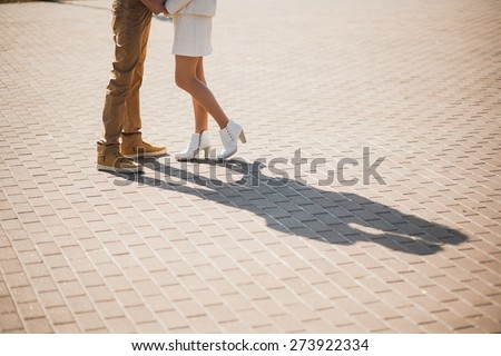 couple in love. boyfriend and girlfriend dating outside. shadows of kissing woman and man. unrecognizable people - stock photo