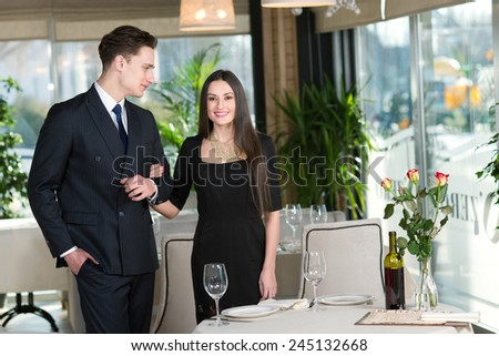 Couple in love came to restaurant for the romantic dinner together - stock photo