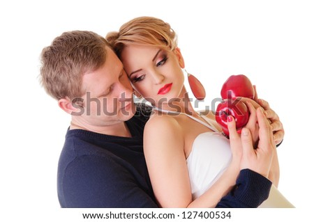 Couple in love - Caucasian man and woman holding red apples in hands, isolated on white background - stock photo
