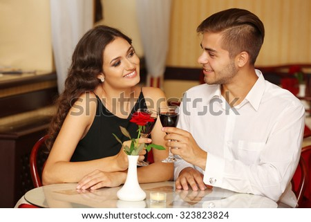 couple in love cheers at the restaurant - stock photo