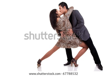 couple in love dancing and kissing, isolated on white, studio shot - stock photo