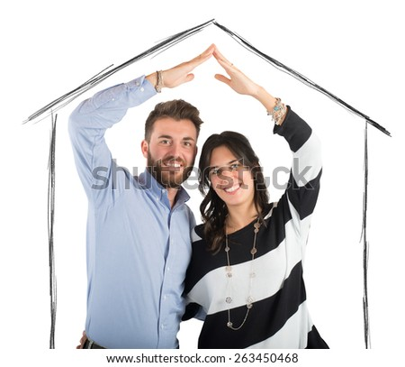 Couple in love dreams a home together - stock photo