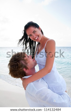 Couple in love enjoying a summer holiday. - stock photo