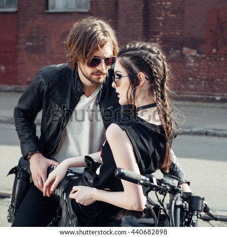 Couple in love. Guy and girl with vintage custom motorcycle. Outdoor lifestyle portrait