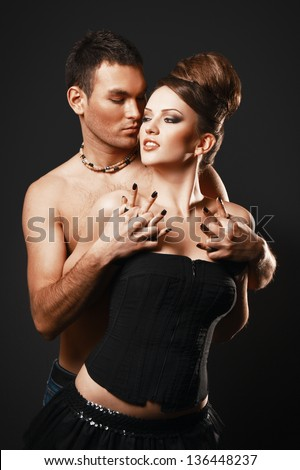 Couple in love. Happy loving couple. Dark background.