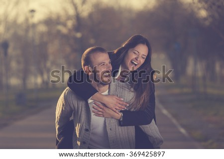 Couple in love having fun outdoors.