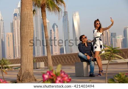 Couple in love having vacation summer fun at sunset.  (focus on couple) - stock photo