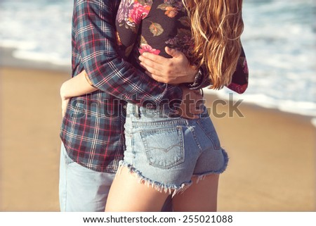 couple in love hugging on the sea - stock photo