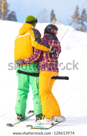 couple in love in a mountain valley - stock photo