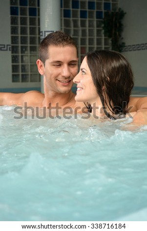 couple in love in jacuzzi enjoying a hydrotherapy session