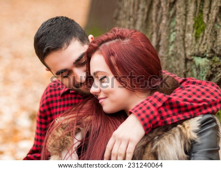 Couple in love in the autumn park