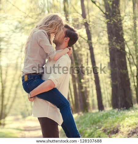 couple in love in the forest - stock photo