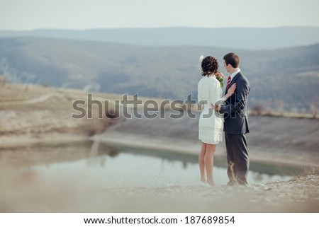 Couple in love in the nature outdoors. Romantic date in the mountains.