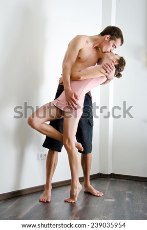 Couple in love in their bedroom - stock photo