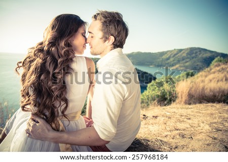 Couple in love kissing at sunset - Lovers on a romantic date outdoors - stock photo