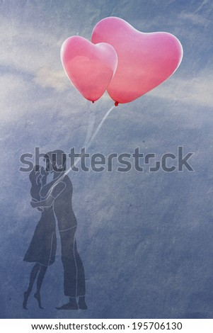 couple in love kissing under the open sky, a couple of balloons in the shape of heart - stock photo