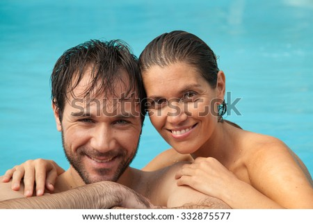 Couple in love looking at camera