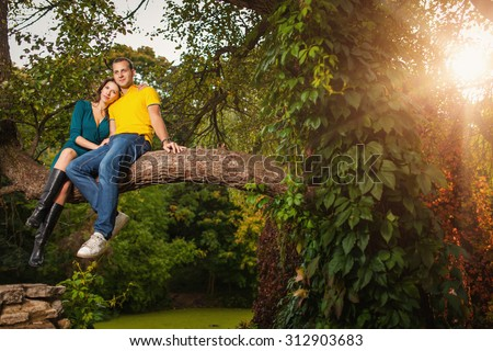 Couple in love: man and woman in colorful fantastic autumn forest