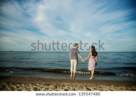 couple in love near sea - stock photo