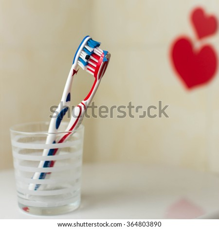 Couple in love of two toothbrushes. Suggesting St. Valentines Day concept. - stock photo