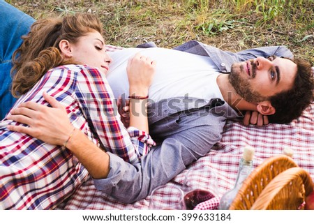 Couple in love on a blanket during a picnic outdoor - stock photo