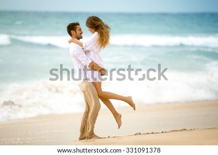 Couple in love on beach, romantic vacation  - stock photo