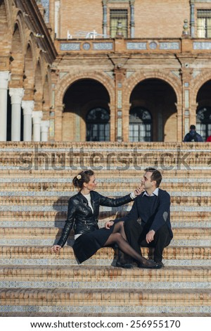 couple in love on Plaza de Espana Seville a popular tourist destination landmark. Romantic couple visiting Spanish tourists attractions sightseeing in Seville, Spain. - stock photo