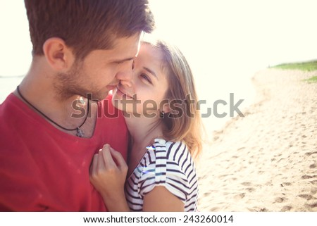 couple in love on the beach - stock photo