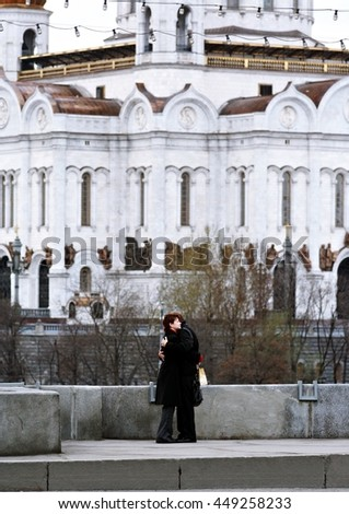 couple in love on the bridge, church and elements, Moscow
