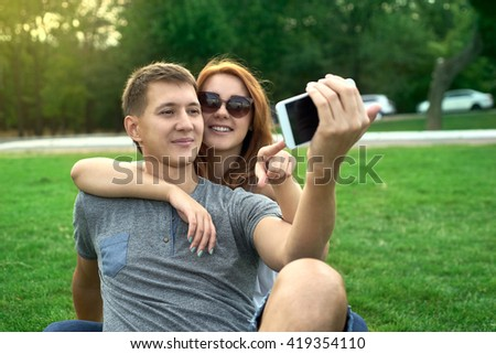 couple in love on the lawn makes self