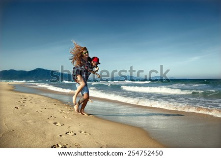 couple in love on the sea playing happily - stock photo