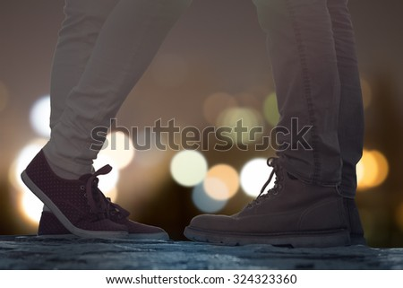 Couple in love on the street with defocused city lights. - stock photo