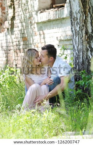 couple in love outdoors near tree