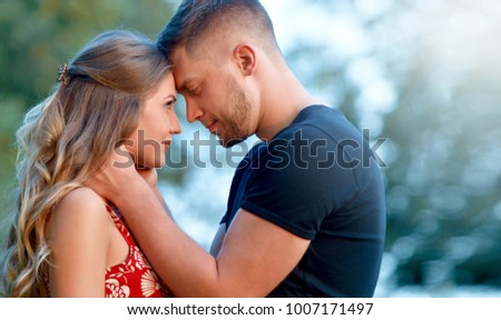 Couple in love passionately hugging. True love among lovers. Sincere emotions and love on the planet