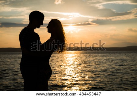Dating  Stock Photos  Royalty Free Images  amp  Vectors   Shutterstock Shutterstock Couple in love silhouette shadow  holding  kissing   seaside  vacation  sunset background