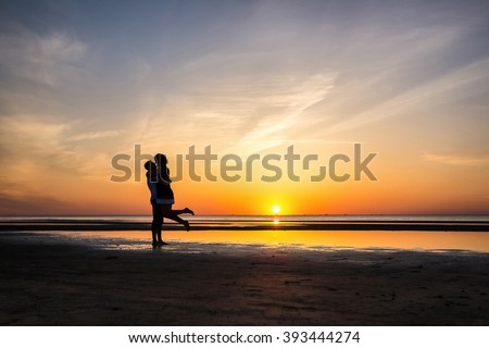 couple in love silhouettes - stock photo