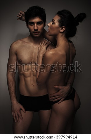 couple in love standing against the background kissing  - stock photo