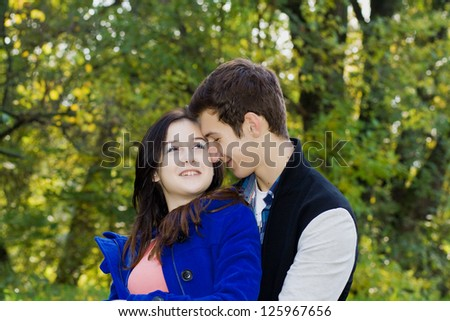 Couple in love talking in the autumn park