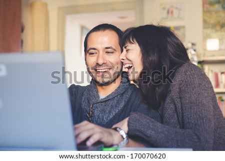 couple in love using notebook - stock photo