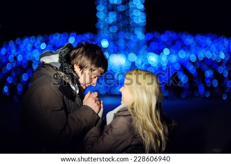 couple in love walking at night winter. - stock photo