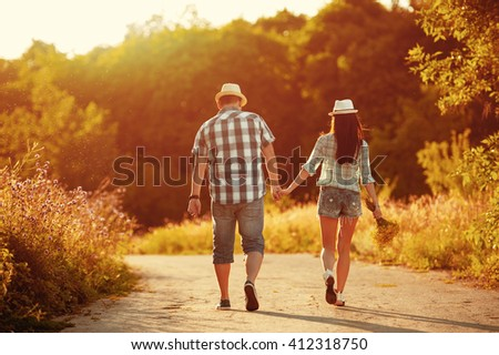Couple in love walking holding hands