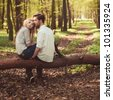 couple in love walking in the woods - stock photo