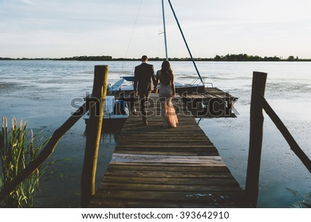 Couple in love walking on the pier