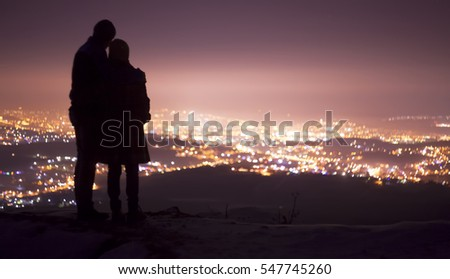 couple in love watching a city background