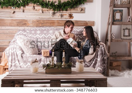 Couple in love watching the Christmas gifts
