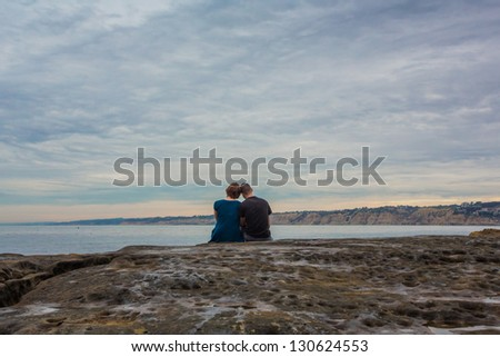 Couple in Love with a Moody Sky